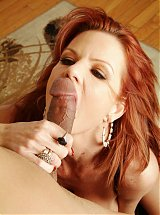 Explicit live cam show with a top heavy mature model named Crystal White riding a cock