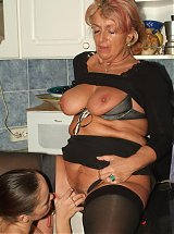 Explicit live cam show with big boobed grandma Joanna Depp seducing a pretty young lady