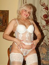 Naughty grandma Erlene bares her clothes and goes to work riding a cock in front of a live cam
