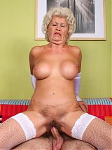 Sensual granny Francesca exposes her pair of big breasts to lure a younger guy into live sex