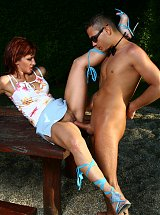 Sexy older babe Myra Cave lures a bartender into fucking her outdoors during a cam show