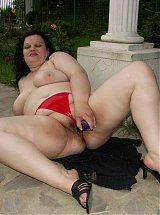 Photos of a mature BBW model stripping her clothes and masturbating outdoors with a dildo